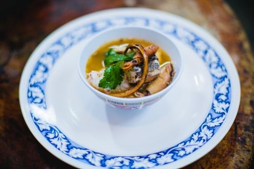 Kok sa ard rice bran mixed with Trang Yib nok rice / Coconut water porridge with Poached Mahi Mahi fish (by Chef Black)